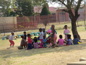 Children at the next door crèche playing in the winter sunshine.